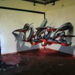 Odeith-Anamorphic-3D-Graffiti-Letters-Orange-fluor-Light-Reflected