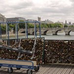 Municipal employees remove the barriers with love padlocks on the Pont des Arts on June 1, 2015 in Paris, France. Yellow-vested officials were out early Monday morning on the city's iconic Pont des Arts, wielding cutting equipment to free the padlocks while a handful of curious tourists looked on. Paris, known worldwide as the city of romance, on Monday began the heart-breaking process of removing nearly one million love-locks, padlocks chained to the city's bridges by love-struck couples. Photo by Stephane Lemouton/Sipa USA
